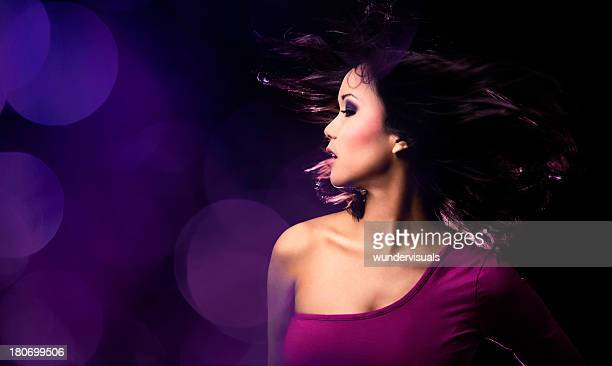 ecstatic dancing girl - purple dress stock pictures, royalty-free photos & images