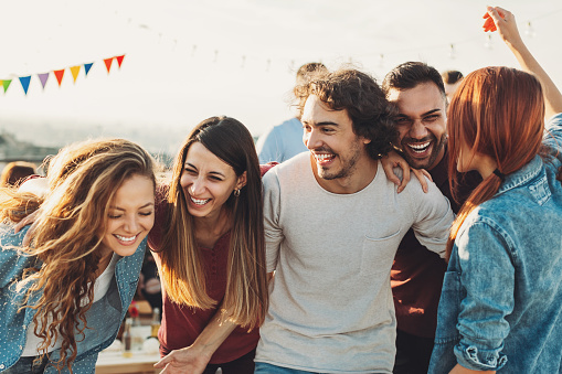 Ecstatic group enjoying the party 643137108