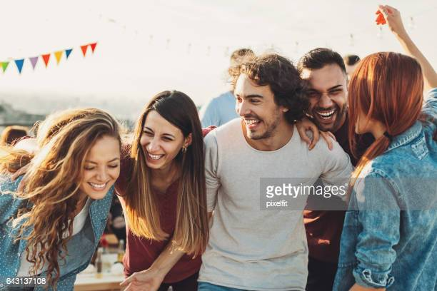 ecstatic group enjoying the party - roof stock photos and pictures
