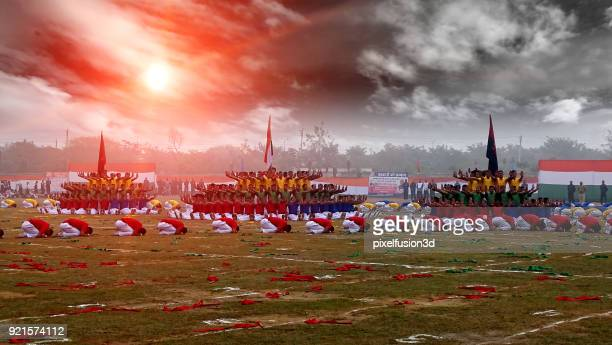 ecstatic group of people performing gymnastic during sunrise in the stadium - republic day stock pictures, royalty-free photos & images