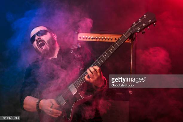 ecstatic guitarist on stage - music style stock pictures, royalty-free photos & images