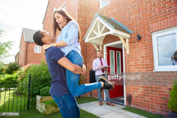 ecstatic homeowners - mortgage stock pictures, royalty-free photos & images
