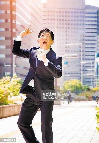 Ecstatic Japanese businessman dances in Tokyo street