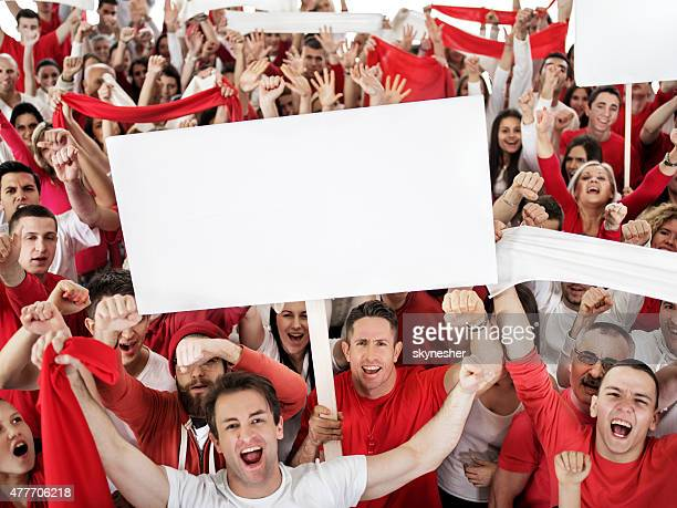ecstatic large group of sport fans shouting and cheering. - placard stock pictures, royalty-free photos & images