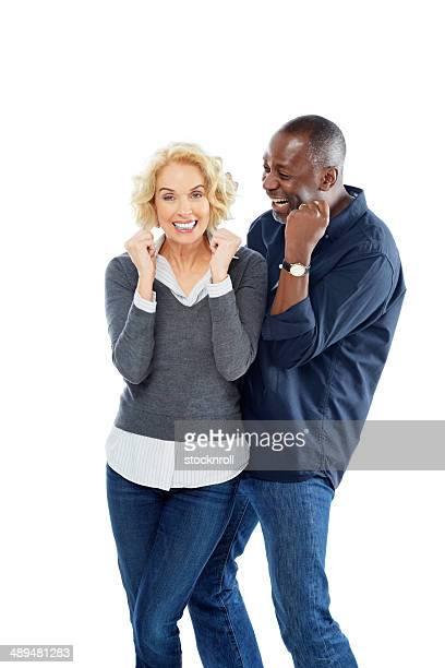 Ecstatic mature interracial couple celebrating success