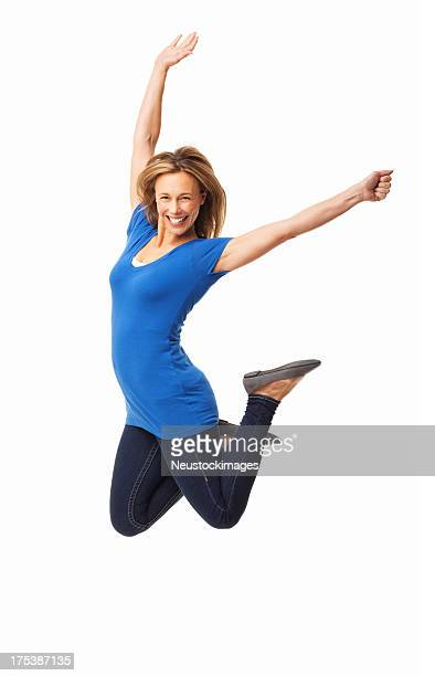 Ecstatic Mid Adult Woman Jumping - Isolated