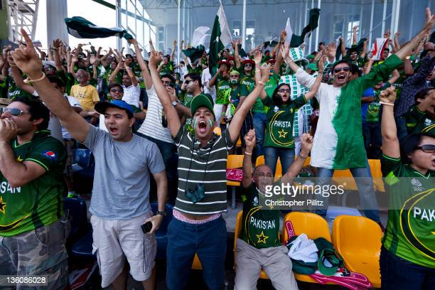 Ecstatic Pakistan fans celebrate a winning ball by their national team against Australia during the Cricket World Cup Premadasa Stadium Colombo Sri...