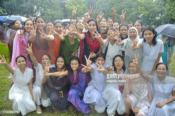 Ecstatic students succeeded in a Higher Secondary Certificate exam express joy after result is brought out at Holy Cross School and College ground in...