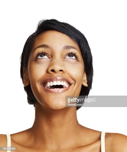 Ecstatic woman smiling while looking up