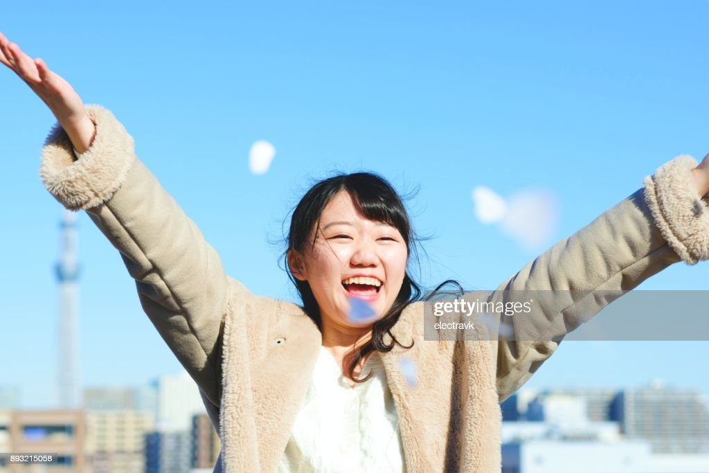 Ecstatic young woman : Stock Photo