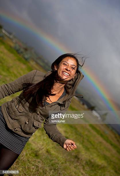 Ecuador, Cayambe, Smiling woman with rainbow in background, Cayambe, Ecuador