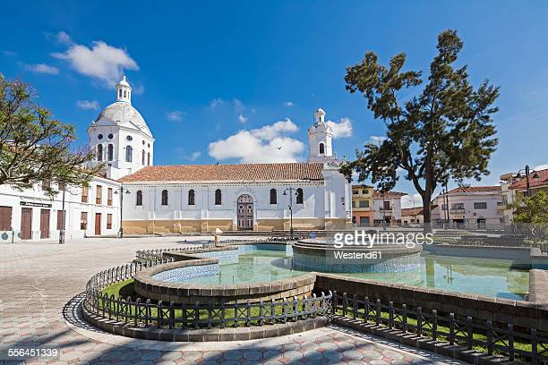 Ecuador, Cuenca, view San Sebastian church with fountain in the foreground