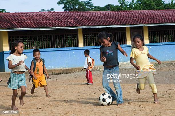 Ecuador Curaray A village without any road connection in the rainforest of the Oriente 150 km east of Puyo Kids playing soccer in the schoolyard...