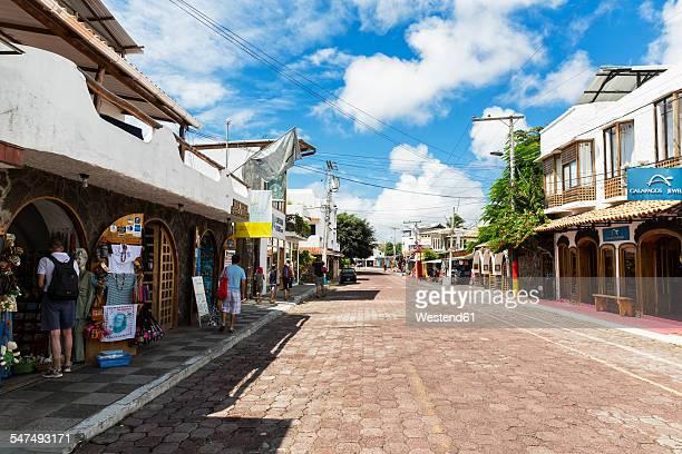ecuador, galapagos islands, santa cruz, shopping street in puerto ayora - puerto ayora stock pictures, royalty-free photos & images