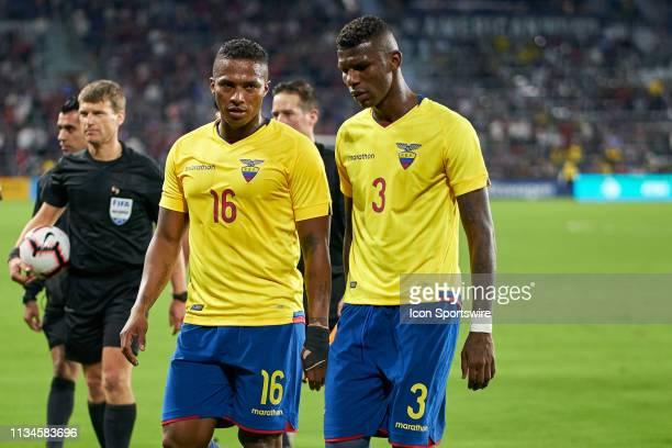 Ecuador midfielder Antonio Valencia and Ecuador defender Robert Arboleda chat in game action during an International friendly match between the...
