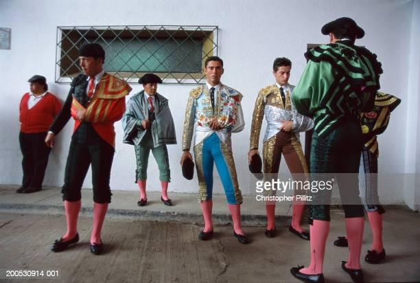 Ecuador, Quito, bullfighters in costume waiting to enter ring