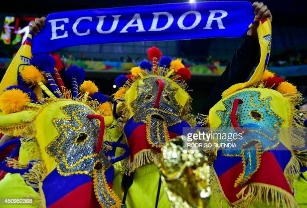 Ecuador supporters in costumes bearung the colours of their national flag cheer as they await the kickoff of a Group E football match between...
