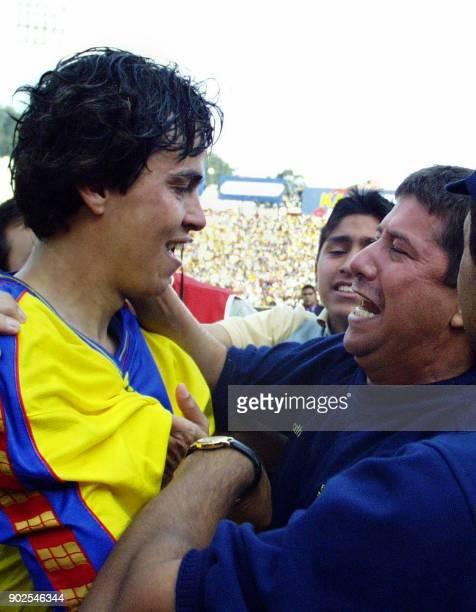 Ecuadoran coach Hernan Dario Gomez celebrates with soccer player Ivan Caviedez the victory of his team against Brazil in Quito Ecuador 28 March 2001...