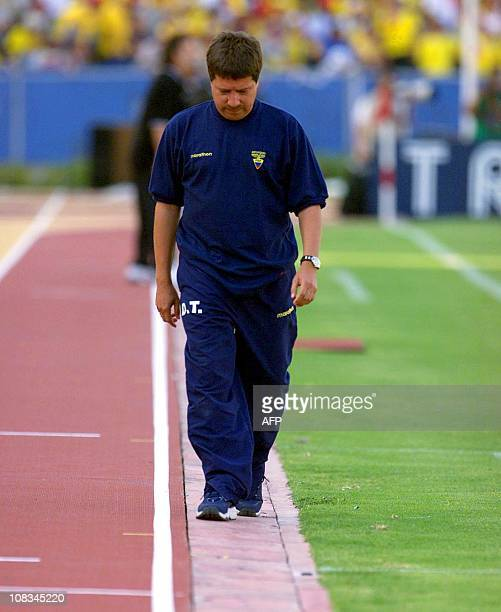 Ecuadoran head coach Hernan Dario Gomez leaves the field dejectedly following his team's loss to Argentina in their 15 August 2001 World Cup...