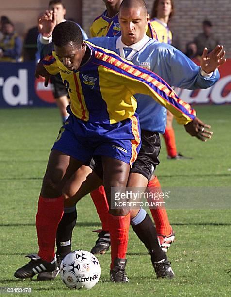 Ecuadoran Ivan Hurtado controls the ball away from Pablo Garcia 04 July 1999 during the Uruguay/Ecuador Copa America match El ecuatoriano Ivan...