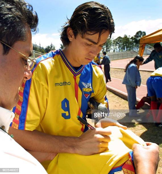 Ecuadoran player Ivan Caviedez autographs a fans shirt on August 13 2001 Team Ecuador will play Argentina on August 15 in a World Cup qualifying game...