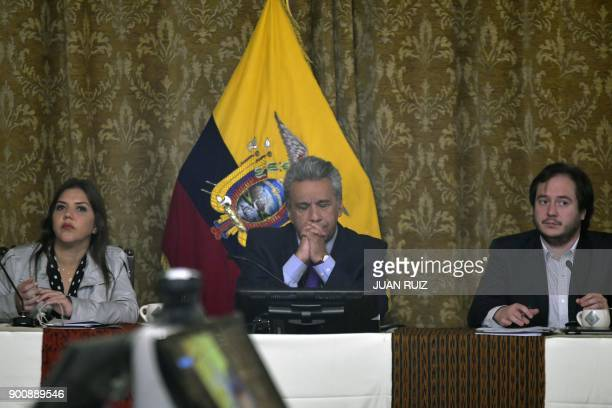 Ecuadoran President Lenin Moreno sitting between his new chief adviser Andres Mideros and Alejandra Vicuna one of three women shortlisted to become...