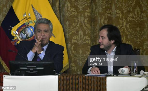 Ecuadoran President Lenin Moreno sitting next to his new chief adviser Andres Mideros announces the removal of Vice President Jorge Glas at a cabinet...