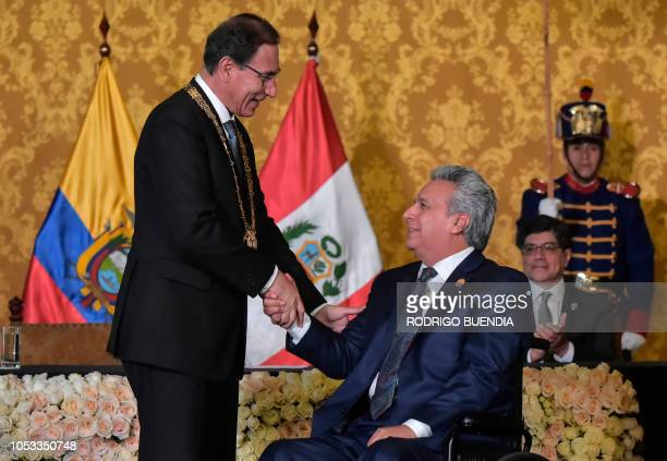 Ecuadoran President Lenin Moreno welcomes his Peruvian counterpart Martin Vizcarra at the Carondelet palace in Quito on October 25 2018 Vizacarra is...