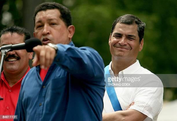 Ecuadoran President Rafael Correa smiles as he listens to a speech by his Venezuelan counterpart Hugo Chavez during an official visit to the city of...
