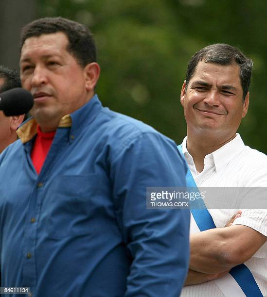 Ecuadoran President Rafael Correa smiles as he listens to a speech by his Venezuelan counterpart Hugo Chavez during an official visit to the city of...