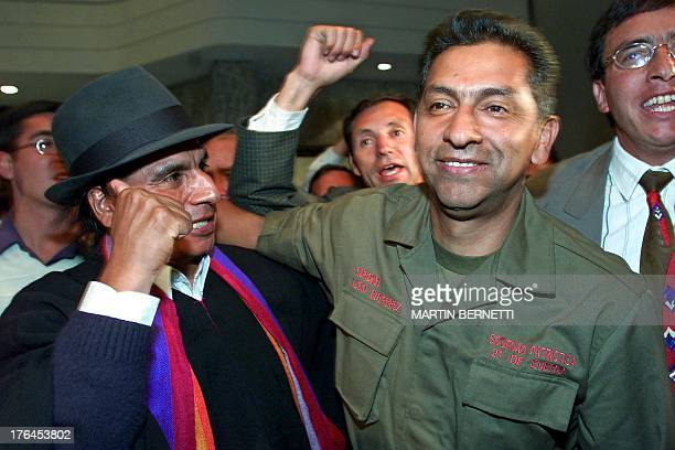 Ecuadoran presidential candidate retired Col Lucio Gutierrez celebrates with indegenous leader Luis Macas and supporters in Quito 20 October winning...