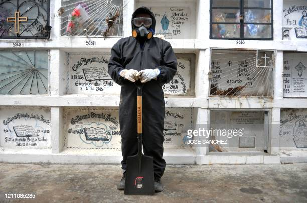Ecuadorean Alexis Pereira who works at the Angel Maria Canals municipal cemetery poses in Guayaquil Ecuador on April 23 2020 during the COVID19...