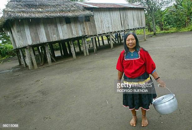 Ecuadorean Cofan Elvira Criollo carries a pot in the village of Dureno in the Amazon region province of Sucumbios 180 km northeast of Quito 20...