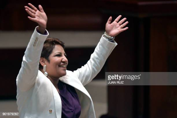 Ecuadorean congresswoman Maria Jose Carrion waves to supporters at the National Assembly plenary during the appointment of Maria Alejandra Vicuna as...