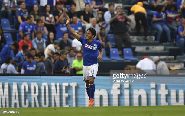 Ecuadorean Cruz Azul's forward Angel Mena celebrates after scoring against Pachuca during their Mexican Clausura football tournament match at the...