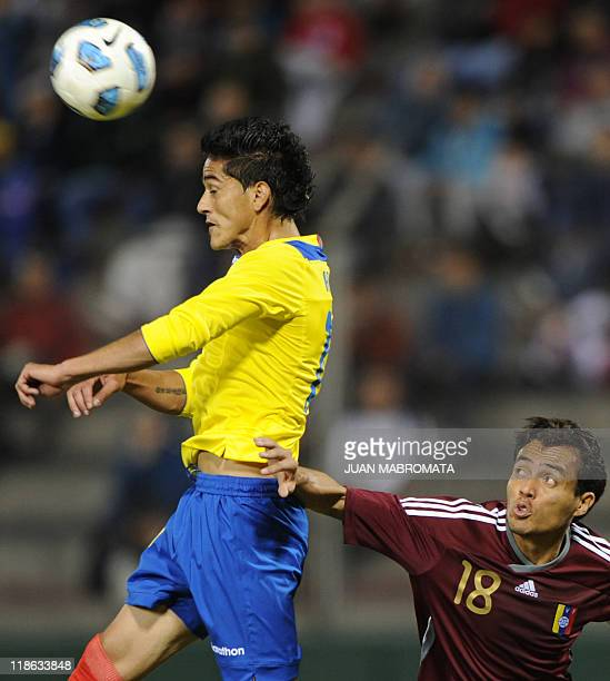 Ecuadorean defender Norberto Araujo jumps for a header next to Venezuelan midfielder Juan Arango during a 2011 Copa America Group B first round...