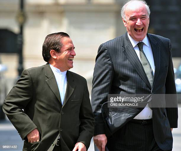 Ecuadorean Foreign Minister Ricardo Patino and his Peruvian counterpart Jose Garcia Belaunde share a laugh after meeting with Peruvian Ppresident...