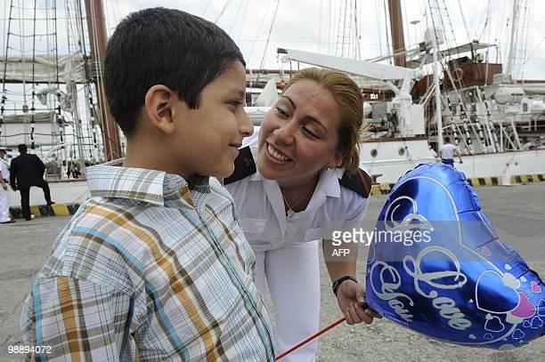 Ecuadorean Jaqueline Jaramillo member of the crew aboard Spanish sailing ship Juan Sebastian De Elcano greets her nephew upon arrival at the port of...