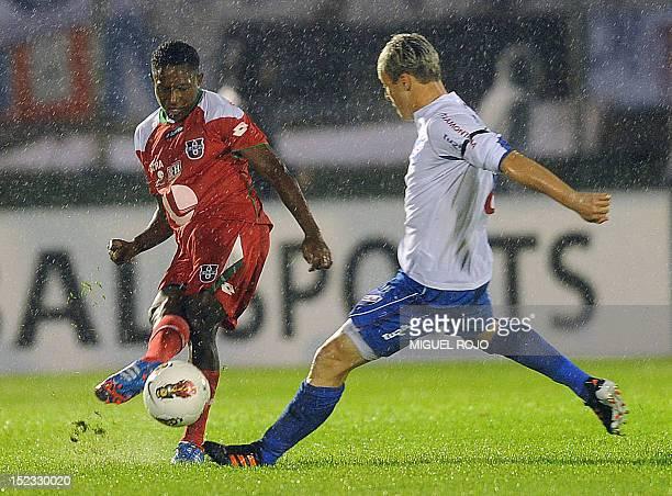 Ecuadorean Liga de Loja's Armando Gomez vies for the ball with Uruguayan Nacional's Israel Damonte, during their Copa Sudamericana football match, at...