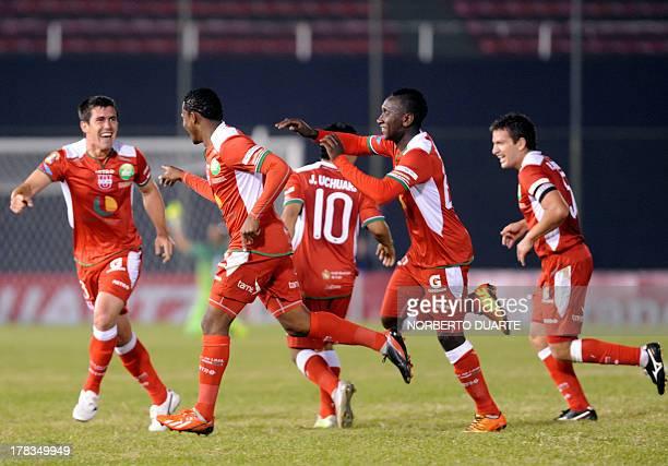 Ecuadorean Liga de Loja's Armando Wila celebrates with teammates after scoring against Paraguayan Nacional, during their 2013 Copa Sudamericana...