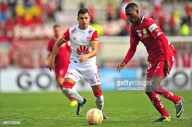 Ecuadorean Liga de Loja's Julio Walberto Ayovi Casierra vies for the ball against Colombian Independiente de Santa Fe's Juan Daniel Roa Reyes, during...