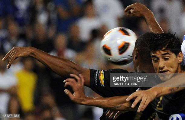 Ecuadorean Liga Deportiva defender Norberto Araujo tries to get the ball against Argentina's Velez Sarsfield during their Copa Sudamericana semifinal...