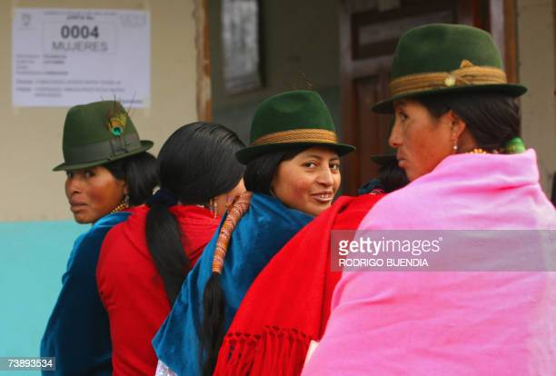 Ecuadorean natives queue at a polling station during a constitutional reform referendum on April 15th in the indigenous community of Cangahua, 90 km...