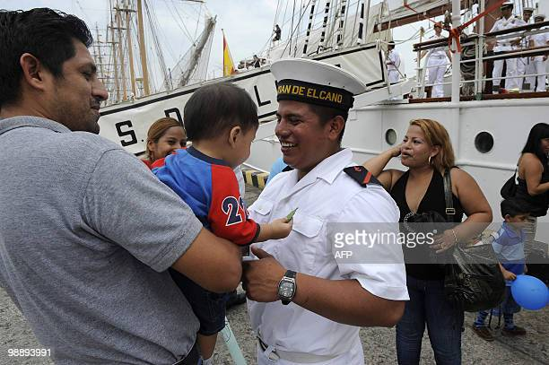 Ecuadorean Pedro mero sailor aboard Spanish sailing ship Juan Sebastian De Elcano meets with relatives upon arrival at the port of Guayaquil May 6...