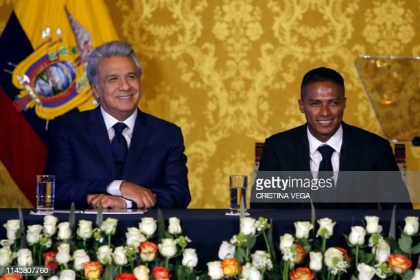 Ecuadorean President Lenin Moreno and ex-Manchester United Ecuadorean footballer Luis Antonio Valencia smile during a ceremony to decorate the latter...