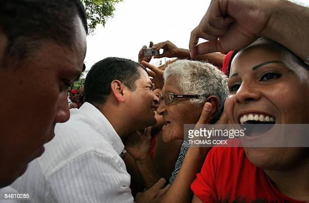 Ecuadorean President Rafael Correa greets supporters during a visit to the city of Cumana state of Sucre 275 kms east of Caracas on February 3 2009...