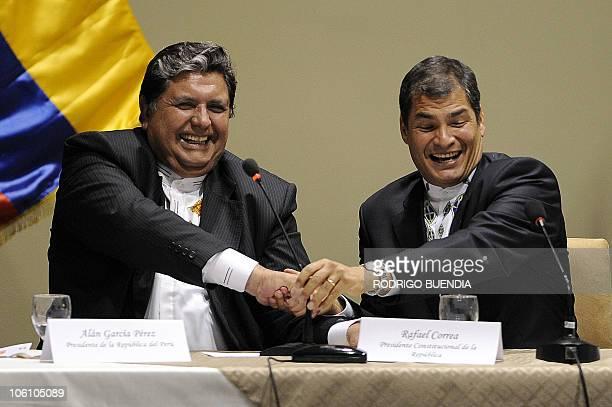 Ecuadorean President Rafael Correa shakes hands with his Peruvian counterpart Alan Garcia during a meeting to sign agreements in Loja, Ecuador on...