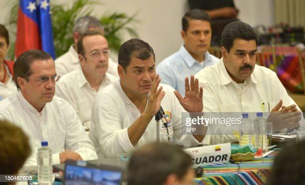 Ecuadorean President Rafael Correa speaks alongside Ministers of Foreign Affairs from Ecuador Ricardo Patino and Venezuela Nicolas Maduro during the...