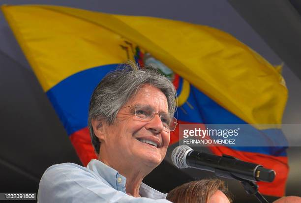 Ecuadorean President-elect Guillermo Lasso speaks to the press as he celebrates his victory after knowing the preliminary results of the run-off...