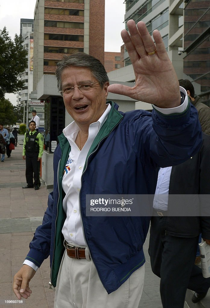 Ecuadorean presidential candidate, banker Guillermo Lasso, of the CREO party, waves to journalists while leaving a local radio station on January 18, 2013, in Quito. Polls show President Rafel Correa, a leftist who has been in office since 2007, the overwhelming favorite to win in the first round of voting giving a lead of as many as 49 percentage points over his closest rival, banker Guillermo Lasso, for the upcoming February 17 elections. AFP PHOTO/Rodrigo BUENDIA